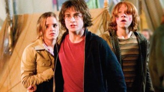 This photo provided by Warner Bros Entertainment shows actors Daniel Radcliffe as Harry Potter, center, Emma Watson as Hermione Granger, left, and Rupert Grint as Ron Weasley in a scene from
