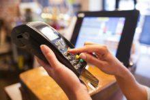 Female payment  close up shop electronic reader plastique card