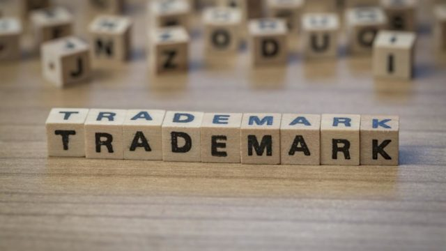Trademark written in wooden cubes on a table
