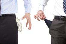 Businessmen grasp money , pocket empty