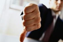 Businessman Giving the Thumbs Down Sign