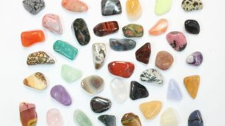 A group of assorted energy healing stones used in therapy.jpg
